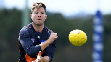 Toby Greene is facing legal action over a drunken attack on a bouncer.