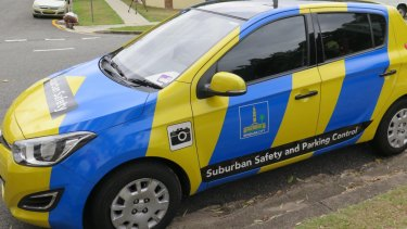A Brisbane City Council parking officer fined two cars within two minutes, despite them both having paid for parking.