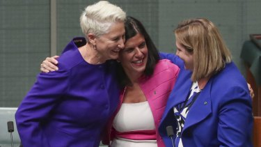 Crossbench MPs Kerryn Phelps, Julia Banks and Rebekha Sharkie celebrate after the Medivac Bill passes the House of Representatives.