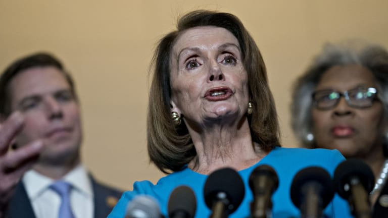 House Minority Leader Nancy Pelosi, a Democrat from California, speaks during a news conference outside a Democratic caucus meeting in Washington, DC ahead of the party taking over Congress in January.