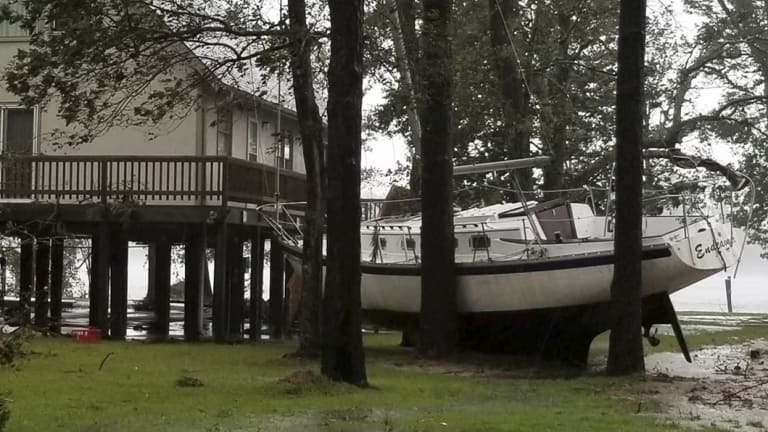 A boat became wedged in trees in Oriental, North Carolina on Friday.