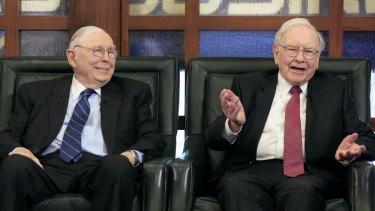 Berkshire Hathaway chairman and CEO Warren Buffett, right, alongside vice chairman Charlie Munger.