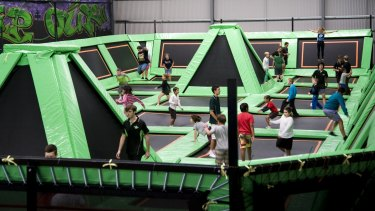 Flip Out runs indoor trampoline parks in Prestons and Canberra, pictured.