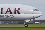 Amsterdam, The Netherlands - May 4, 2015: A Boeing 777-FDZ of Qatar Airways Cargo lands at Amsterdam Airport Schiphol (The Netherlands, AMS) on May 4, 2015. The name of the runway is Polderbaan. iStock image for Traveller. Re-use permitted. World's shortest flights