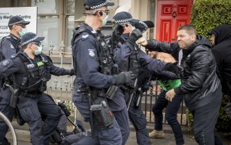 Victoria Police confront protesters in Victoria Street, North Melbourne, on May 29 for breaching lockdown directives. No social distancing there either.