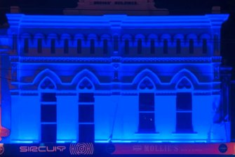 Sircuit bar in Fitzroy bathed in blue as a tribute to the four police officers killed in the Eastern Freeway tragedy.