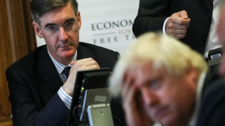 Jacob Rees-Mogg, looks at Boris Johnson, the former UK foreign secretary, earlier this year.