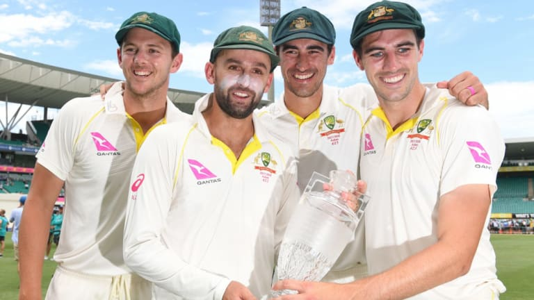 Australia's attack: Josh Hazlewood, Nathan Lyon, Mitchell Starc and Pat Cummins with the Ashes trophy.