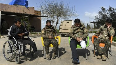 These wounded Kurdish soldiers are helping each other recuperate, but need medical attention.
