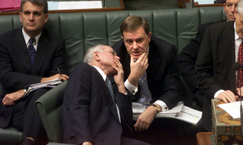 Treasurer Peter Costello counsels Prime Minister John Howard in question time in 2002.
