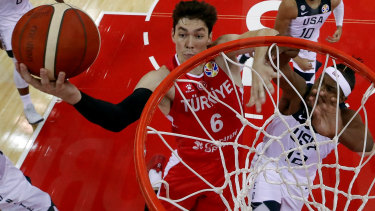 Direct approach: Cedi Osman drives to basket against Myles Turner of USA.