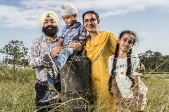Kanwar Jeet (far left), one of the volunteers behind the establishment of Australia's first Sikh school, with his family.