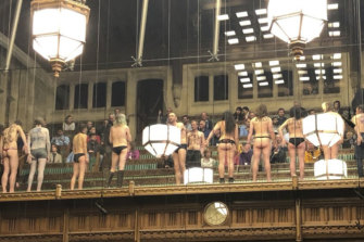 Naked activists glued themselves to the glass in the House of Commons in London in April.