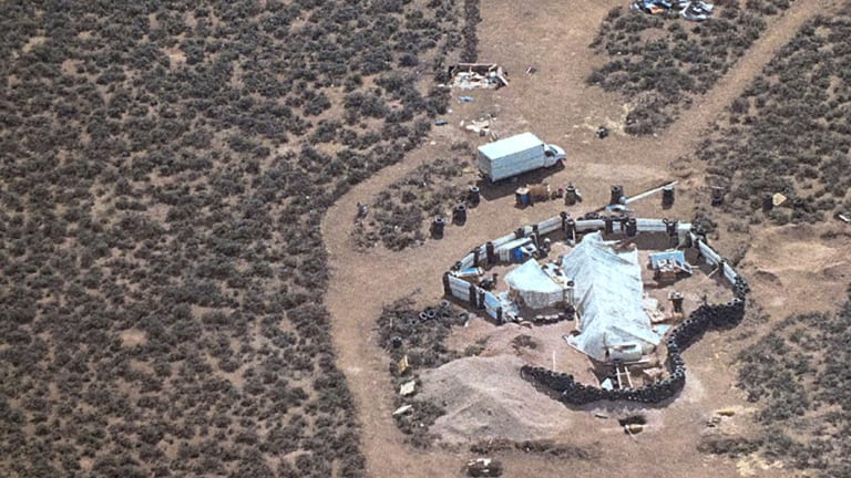 An aerial photo released by Taos County Sheriff's Office shows a rural compound during an unsuccessful search for a missing three-year-old boy in New Mexico.