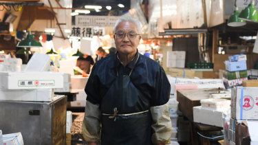 Mikio Wachi, 73, who has run a tuna wholesaler for 48 years and opposed the relocation of Tsukiji, the famed wholesale seafood market in Tokyo, pictured on the last day on Saturday.