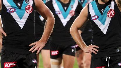 Port Adelaide players exonerated over missing masks