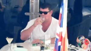 James Packer relaxes on IJE with girlfriend Kylie Lim.