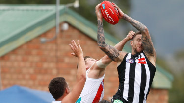 High flier: Magpie Jeremy Howe takes a trademark screamer during a pre-season match at Morwell.