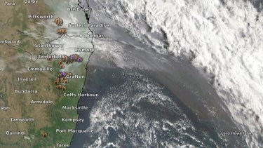 A satellite image shows smoke from northern NSW bushfires sweeping across the Tasman towards Lord Howe Island.