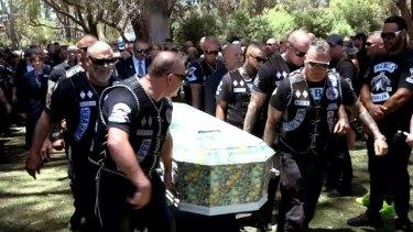 Slain Rebels bikie boss Nick Martin is laid to rest at Pinnaroo cemetery.