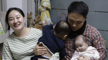 A South Korean woman Seo Hyo Sun, left, speaks during an interview at her home in Buchon, South Korea. Every baby born in South Korea last year considered to be 2 on January 1.