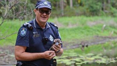 Queensland police Senior Constable Craig Hughes with Connie the platypus.