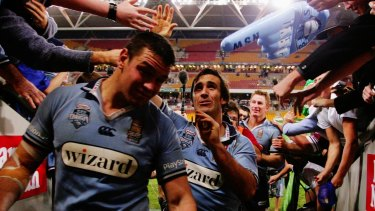 Andrew Johns and Blues teammates walk off after their victory in the 2005 series decider at Suncorp.