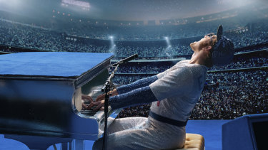 Taron Egerton as Elton John in a scene from Rocketman.