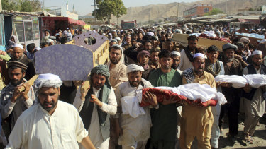 Baghlan province residents carry the bodies of children killed in an air strike in northern Afghanistan on Saturday.