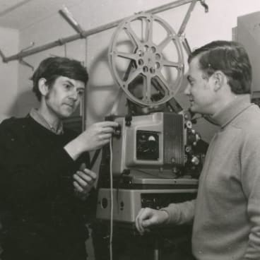 Arthur Cantrill and Andrew Pike in a projection booth at theANU's Coombs Theatre in1969.