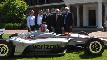 The silver Chevrolet car Will Power drove to victory last year, on Joe Hockey's front lawn.