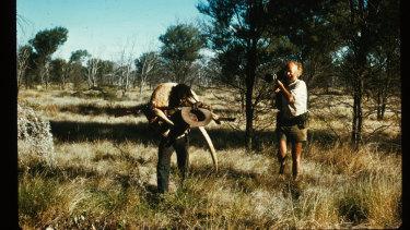Ian Dunlop filming Shorty Bruno (carrying kangaroo) near Yayayi, Northern Territory, 1974.