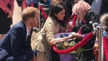 Britain's Prince Harry, the Duke of Sussex and his wife Meghan, the Duchess of Sussex meet with 98 year-old Daphne Dunne.