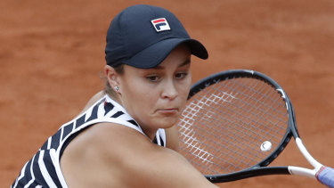 Ash Barty in action against her opponent from the previous round, Danielle Collins.