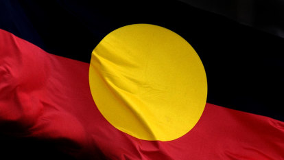 Fly the Aboriginal flag at half mast on January 26