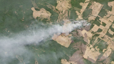 This August 20 satellite image courtesy of Planet Labs shows smoke billowing from fires in Mato Grosso, Brazil.
