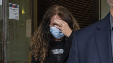 UTS professor Dianne Jolley holds a hand to her face as she leaves court on Tuesday.
