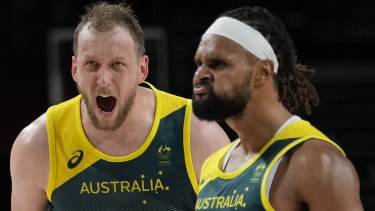 Roar emotion: Joe Ingles and Patty Mills are pumped up as success against Slovenia looms.