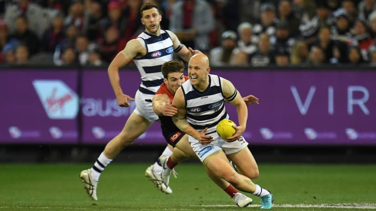 Jack Viney of the Demons (centre) and Gary Ablett of the Cats (right) contest at the MCG during the first elimination final.