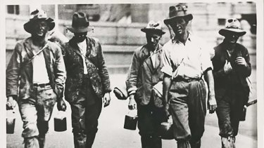 Five men looking for work during the Great Depression.