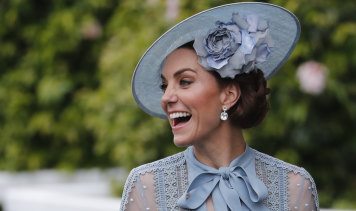 Duchess of Cambridge smiles upon her arrival on day one of the annual races at Royal Ascot.