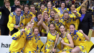 Briony Akle (front, second from left), Megan Anderson (front right) and the Sydney Swifts celebrate victory in the Commonwealth Bank Trophy grand final in 2001.