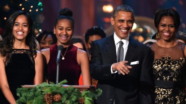 Barack and Michelle Obama with their daughters Malia and Sasha in 2014.