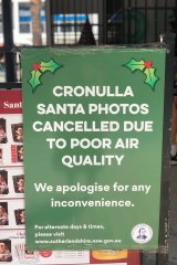 A sign apologising for Santa's absence at Cronulla Mall, with Scott Morrison's office in the background.