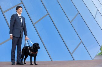 """""""Just being respectful really helps us"""": Scott Grimley and his Guide Dog Dudley."""