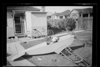 Zoe the Police Dog, with her plane under construction. Negatives unearthed from the Forensic Police Archive, Sydney.