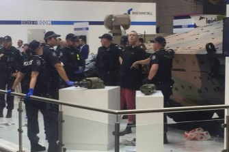 A protester reportedly climbed on top of a tank and locked themselves to it.
