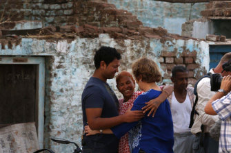 Saroo with his birth mother, Fatima, and Sue in Khandwa, India. Saroo and Fatima were reunited after being separated for 25 years.