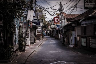 Poppies Lane in Kuta is completely deserted, with most businesses closed and no tourists in sight.