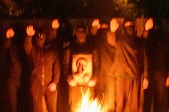 Members of the National Socialist Network celebrate Adolf Hitler's birthday.